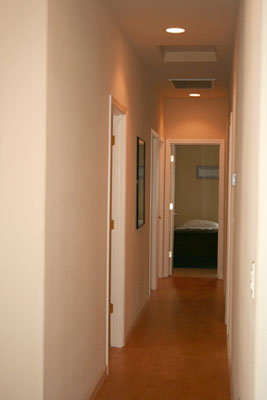 Traveling down the hallway from the living room, are four nicely sized bedrooms.