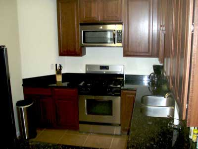 The kitchen has all the modern appliances to cook a gourmet meal or simply heat up leftovers.